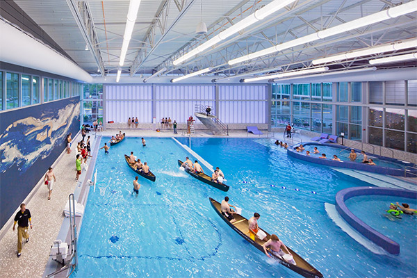 Swimming pool featuring users in canoes